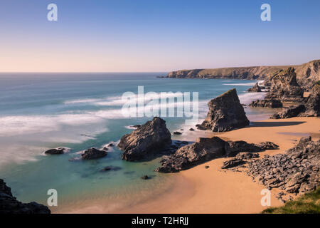 Dramatic cliffs and sea stacks at Bedruthan Steps and beach, on the north Atlantic coast of Cornwall, England, UK. March 2019. - Stock Photo