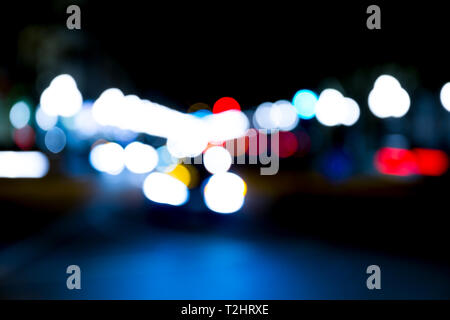 abstract traffic lights on urban street at night, abstract bokeh, blurred motion - Stock Photo