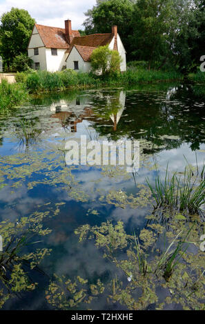 Willy Lotts Cottage reflected in the River Stour, Flatford Mill - Stock Photo
