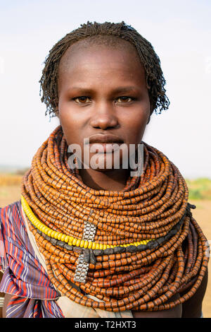 Portrait of a traditional Nyangatom woman in southern Ethiopia - Stock Photo