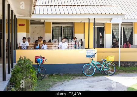 La Dique, Seychelles - February 4th, 2019: People in the waiting hall at the Logan Public Hospital in La Digue, Seychelles. - Stock Photo