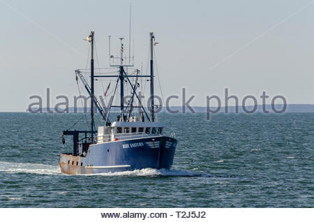 Fairhaven, Massachusetts, USA - April 2, 2019: Commercial fishing vessel Blue Eastern coming out of Buzzards Bay with Elizabeth Islands in background - Stock Photo
