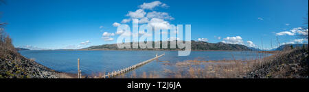 Panoramic View of Large Oregon Lake With Sunny Blue Skies - Stock Photo