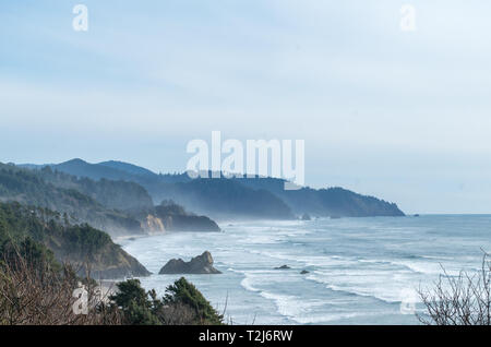 Aerial View of the Pacific Coast of Oregon With Fog and Cloudy Skies - Stock Photo