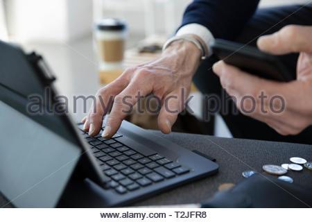 Close up businessman using digital tablet - Stock Photo