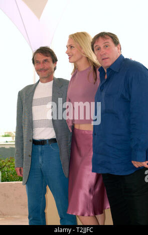 CANNES, FRANCE. May 11, 2000:  French actor Gerard Depardieu (right) With Uma Thurman & Director Roland Joffe at the Cannes Film Festival where their new movie - Vatel - is the opening night film .  11 May 2000. Picture: Paul Smith/Featureflash - Stock Photo