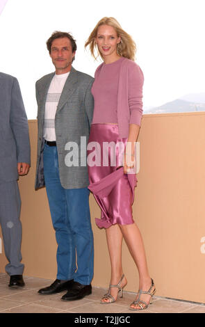 CANNES, FRANCE. May 10, 2000:  Actress Uma Thurman & Director Roland Joffe at the Cannes Film Festival where their movie Vatel opened the event. Picture: Paul Smith/Featureflash - Stock Photo