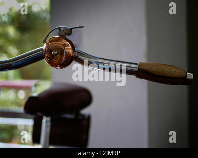 bell mounted on a handlebar on an old bicycle during an expo on museo el castillo medellin colombia - Stock Photo