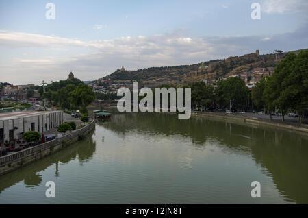 View from the Bridge of Peace in Tbilisi, a pedestrian bridge over the Mtkvari River in Tbilisi, Georgia - Stock Photo