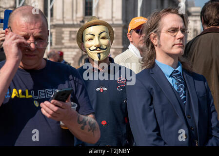 Brexit supporters at a rally outside the Houses of Parliament on 29 March 2019 - the day the UK was supposed to leave the EU. - Stock Photo