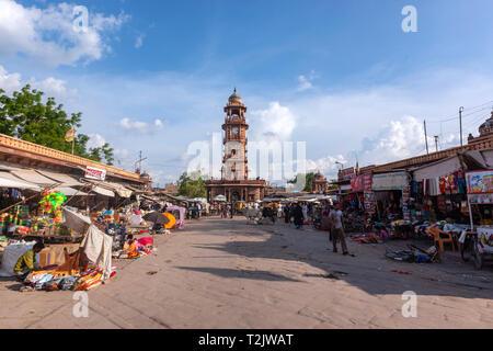 Busy people around Sadar Market with the Ghanta Ghar, clock tower,  in Jodhpur, Rajasthan, India - Stock Photo