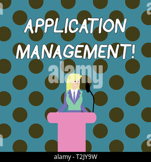 Word writing text Application Management. Business photo showcasing analysisaging applications throughout their lifecycle Businesswoman Standing Behin - Stock Photo