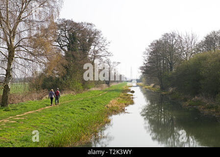 Young couple walking along the towpath of the Pocklington Canal, East Yorkshire, England UK - Stock Photo