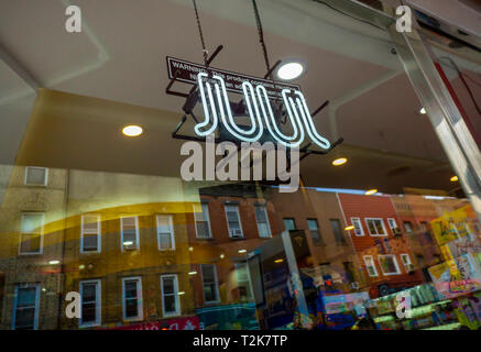 An illuminated sign in the window of a store in Brooklyn in New York on Saturday, March 30, 2019 advertises Juul brand vaping products. (© Richard B. Levine) - Stock Photo