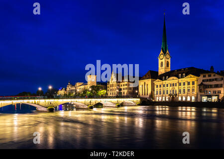 Night view of historic Zurich city center with famous Fraumunster Church and river Limmat in Zurich, Switzerland. - Stock Photo