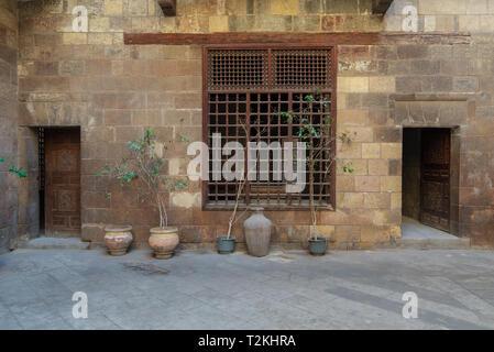 Facade of Zeinab Khatoun historic house, located near to Al-Azhar Mosque in Darb Al-Ahmar district, Old Cairo, Egypt - Stock Photo