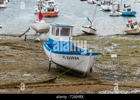 Perros-Guirec, France - July 30, 2018: Boats stranded at low tide in the beach of Saint-Guirec - Stock Photo