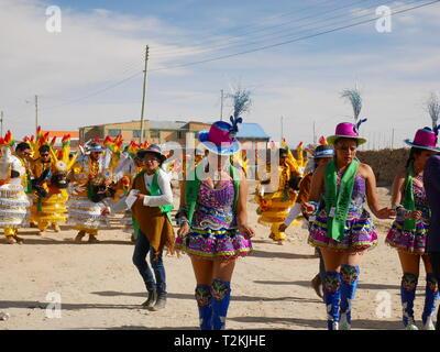 UYUNI, BO - CIRCA OCT 2018 - Popular parade with masks in Colchani, Bolivia, South America - Stock Photo