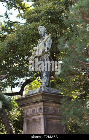 A statue of Umashimadenomikoto, at Hamarikyu Gardens in Tokyo, Japan. - Stock Photo