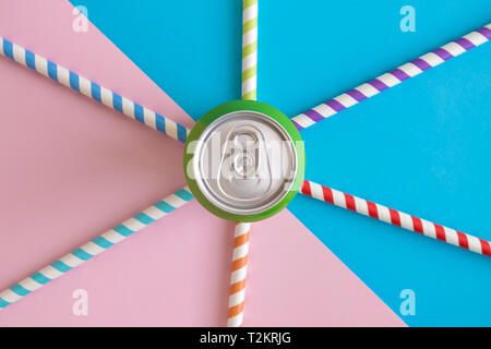 Flat lay of aluminum can and colorful drinking straws on pastel background minimal summer drink creative concept. - Stock Photo