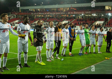 sports, football, Lower Rhine Cup, 2018/2019, semifinal, Rot Weiss Essen vs KFC Uerdingen 0-2, Stadium Essen, Hafenstrasse, after the game Krefeld players and football fans rejoicing at the win - Stock Photo