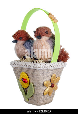 Easter handmade  basket nest from rope and pasta  with funny birds  and quail eggs. Isolated on white studio macro shot - Stock Photo