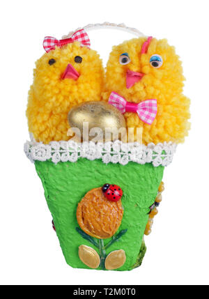 Easter handmade  nest from paper and pasta  with funny chickens and golden egg. Isolated on white studio macro shot - Stock Photo