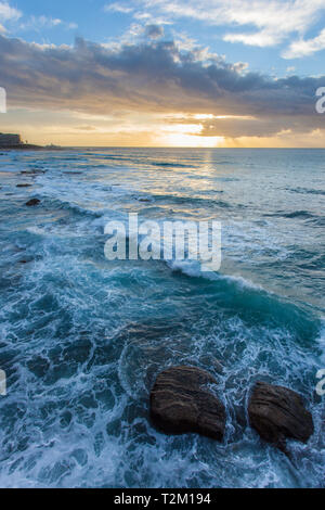 Sunrise at Newcastle Beach - New South Wales Australia. Located on the coast a few hours north of Sydney Newcastle is the largest regional  city in Au - Stock Photo