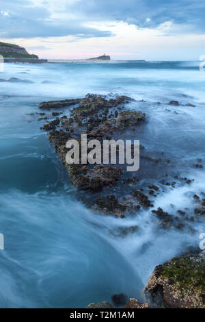 Rugged coastline towards Nobbys Lighthouse at Newcastle Ocean Baths - Newcastle Australia. Newcastle is New South Wales second largest city with some  - Stock Photo