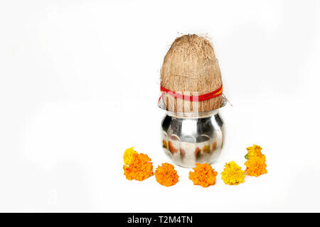 Portrait of kalash with coconut and marigold flower for navratri festival. Isolated on the white background. - Stock Photo
