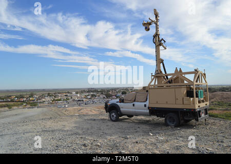 A Mobile Surveillance Camera on Garcia's Hill at the Andrade Point of Entry in Yuma, Arizona, March 28, 2019. The Department of Defense has deployed units across the Southwest Border at the request of U.S. Customs and Border Protection and is providing logistical, engineering, and force protection functions. (US Army photo by Sgt. 1st Class TaWanna Starks) - Stock Photo