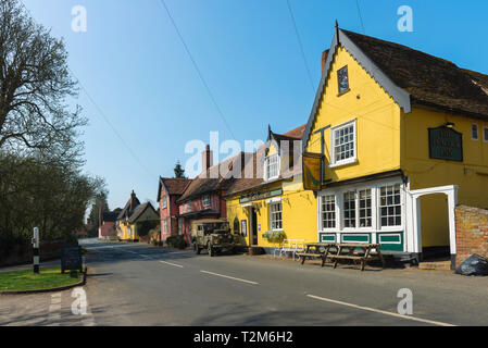 Chelsworth Suffolk, view of The Peacock Inn pub and colourful houses sited along The Street in the centre of the village of Chelsworth, Suffolk, UK - Stock Photo