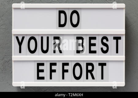 'Do your best effort' words on lightbox over concrete surface, top view. Overhead, from above. Flat lay. - Stock Photo