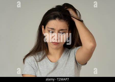 Close up of young sad latin woman looking worried and thoughtful. Feeling hopeless and distressed suffering from depression. Portrait with Copy space. - Stock Photo