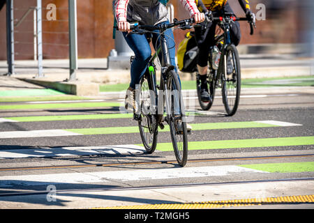 Together with beloved for walk on bicycles to sweat practicing in fast cycling relax at wheel of a bicycle to talk combining business with pleasure le - Stock Photo