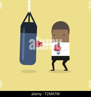 African businessman wearing boxing gloves and punching the punch bag. - Stock Photo