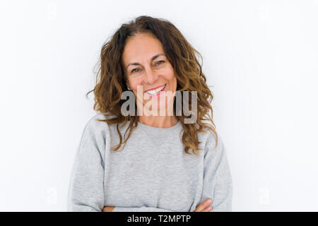 Beautiful middle age woman with curly hair smiling cheerful and happy, laughing with a big smile on face showing teeth over white isolated background - Stock Photo