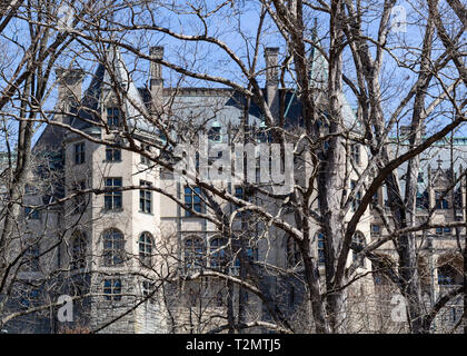 The rear view of the Biltmore House can be seen from a trail through trees in Asheville, North Carolina, USA - Stock Photo