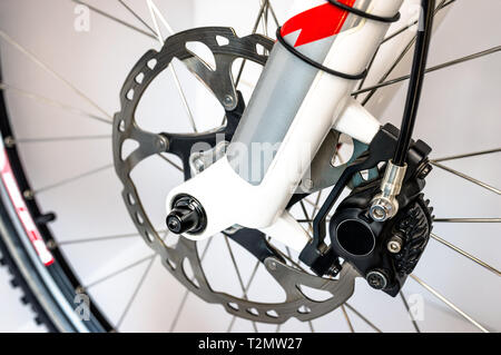 Hydraulic front disc brake on mountain bike. Isolated on a white background. High resolution, full frame. - Stock Photo