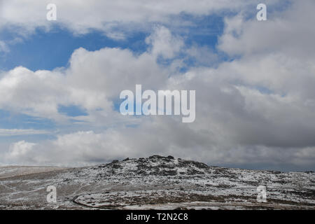 Princetown, Dartmoor, Devon, UK. 3rd April 2019. UK Weather. Snow still lying on the hills ofr Dartmoor this morning. Credit: Simon Maycock/Alamy Live News - Stock Photo