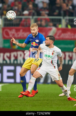 Augsburg, Germany. 02nd Apr, 2019. Marco RICHTER, FCA 23 compete for the ball, tackling, duel, header, zweikampf, action, fight against Konrad LAIMER, RB Leipzig 27 FC AUGSBURG - RB LEIPZIG 1-2 n.V. DFB-Pokal, German Football Trophy, Augsburg, April 02, 2019 Season 2018/2019, Red Bull, Soccer, Credit: Peter Schatz/Alamy Live News - Stock Photo