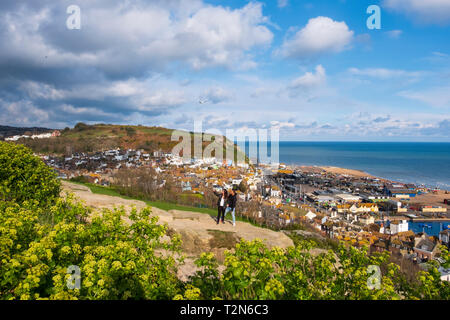 Hastings, East Sussex, UK. A couple take a selfie in the late afternoon sun, of the picturesque view from West Hill, overlooking the Old Town harbour, on the South Coast - Stock Photo