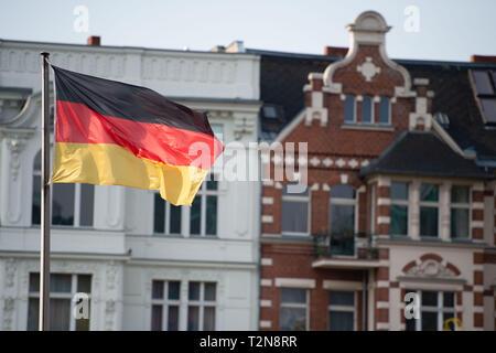 Berlin, Germany. 03rd Apr, 2019. A German flag is flying in Berlin's Alt-Moabit district. Credit: Lisa Ducret/dpa/Alamy Live News - Stock Photo