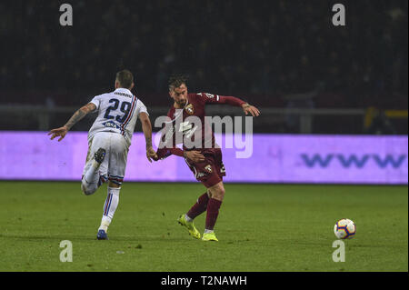 Turin, Italy. 03rd Apr, 2019. Vittorio Parigini of Torino FC and Nicola Murru of U.C. Sampdoria during the Serie A match at Stadio Grande Torino, Turin Credit: Antonio Polia/Alamy Live News - Stock Photo