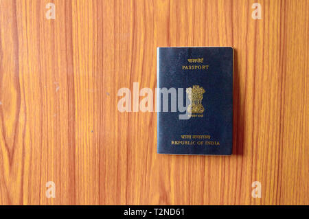 Indian Passport book on wooden table hardwood floor. Close up. Travel tourism and holiday vacation concept. Mockup. Top high angel view object with cl - Stock Photo