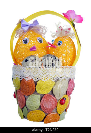Easter handmade  basket  from rope and pasta  with funny chickens and guail eggs. Isolated on white studio macro shot - Stock Photo