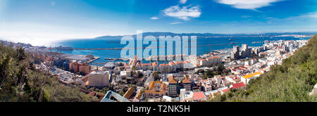 Awesome panoramic view of Gibraltar city and the bay of Algeciras, seen from the top of the rock - Stock Photo