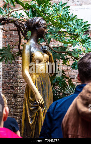 People visiting the statue of Juliet and Juliet's balcony in Verona Italy - Stock Photo