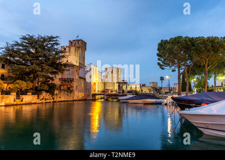 Rocca Scaligera Castle at sunset in Sirmione, Garda Lake, Italy