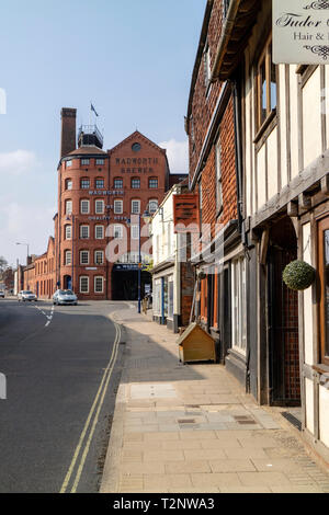 Devizes, Wiltshire, England, UK. March 2019. View along the main street to the Wadworth Brewery building. - Stock Photo